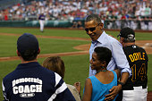 President Barack Obama greets Congresswoman Donna Edwards during the 2015 Congressional Baseball Game at the National Parks Stadium on June 11 2015...