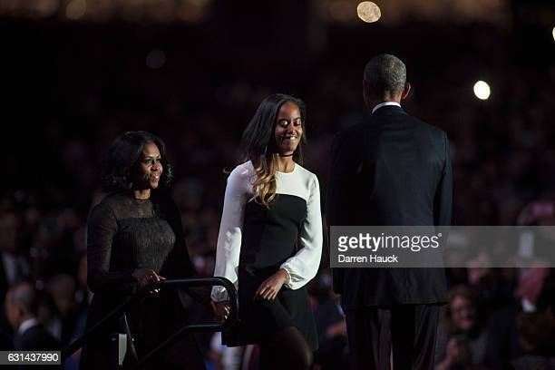 S President Barack Obama greets daughter Malia and first lady Michelle Obama on stage after delivering his farewell address at McCormick Place on...