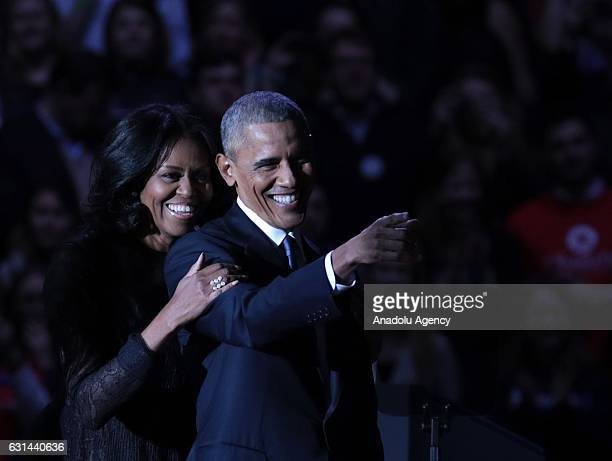 S President Barack Obama greets daughter Malia and first lady Michelle Obama on stage after delivering his farewell address at the McCormick Place...