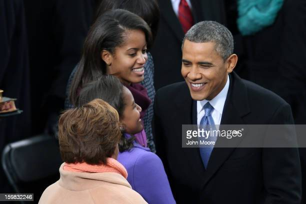 S President Barack Obama greets daughters Sasha Obama and Malia Obama during the presidential inauguration on the West Front of the US Capitol...
