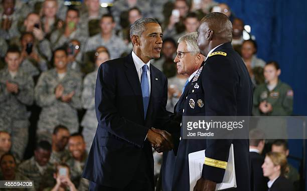 S President Barack Obama greets Defense Secretary Chuck Hagel and General Lloyd Austin commander of US Central Command as he arrives on stage to...