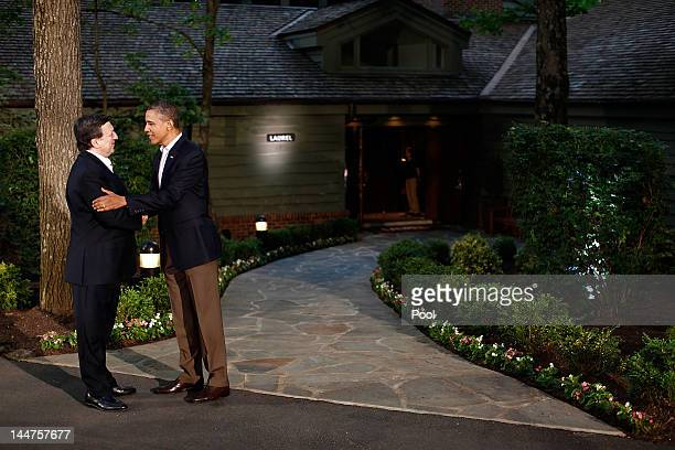 S President Barack Obama greets European Commission President Jose Manuel Barroso in front of Laurel Lodge at Camp David during the 2012 G8 Summit on...