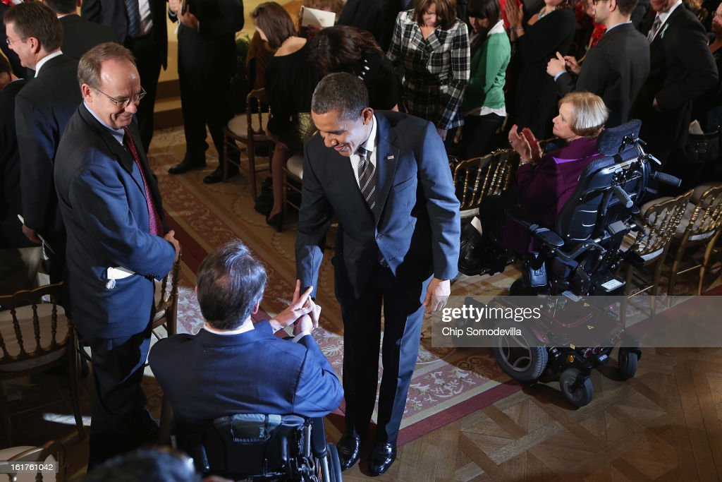 U.S. President Barack Obama greets guests after presenting recepients with the 2012 Presidential Citizens Medal, the nation's second-highest civilian honor, in the East Room of the White House February 15, 2013 in Washington, DC. 'Their selflessness and courage inspire us all to look for opportunities to better serve our communities and our country,' Obama said about this year's recepients.