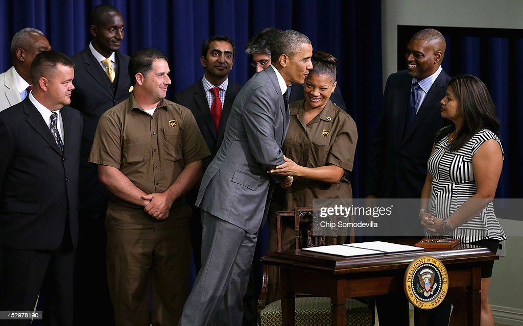 U.S. President <a gi-track='captionPersonalityLinkClicked' href=/galleries/search?phrase=Barack+Obama&family=editorial&specificpeople=203260 ng-click='$event.stopPropagation()'>Barack Obama</a> greets guests after signing an executive order that requires government contractors to make public previous labor law violations and give their workers more rights to address disputes in the Eisenhower Executive Office Building July 31, 2014 in Washington, DC. Obama signed the labor order a day after House Republicans voted to go forward with a lawsuit against the president in an attempt to stop him from acting on his own with executive orders.