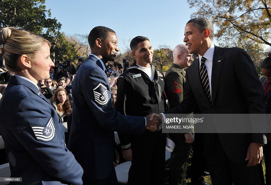 US President Barack Obama greets guests after the annual Thanksgiving turkey pardon November 21 , 2012 at the Rose Garden of the White House in Washington, DC. Obama pardoned Cobbler and its alternate Gobbler, both raised in Rockingham County, Virginia. The turkeys will then spend the rest of the holiday season on display at George Washington's Mount Vernon estate. AFP PHOTO/Mandel NGAN