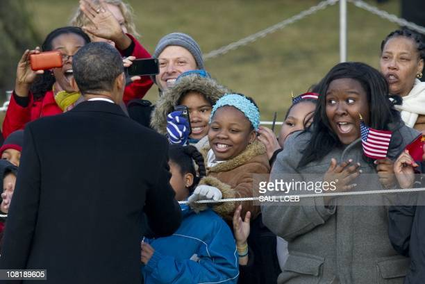 US President Barack Obama greets guests alongside Chinese President Hu Jintao during a State Arrival ceremony on the South Lawn of the White House in...
