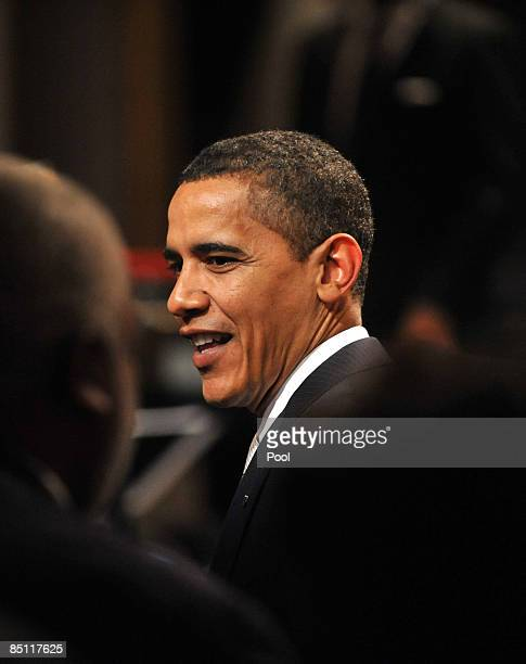 US President Barack Obama greets guests as he and First Lady Michelle Obama host an evening of celebration in honor of musician Stevie Wonder's...