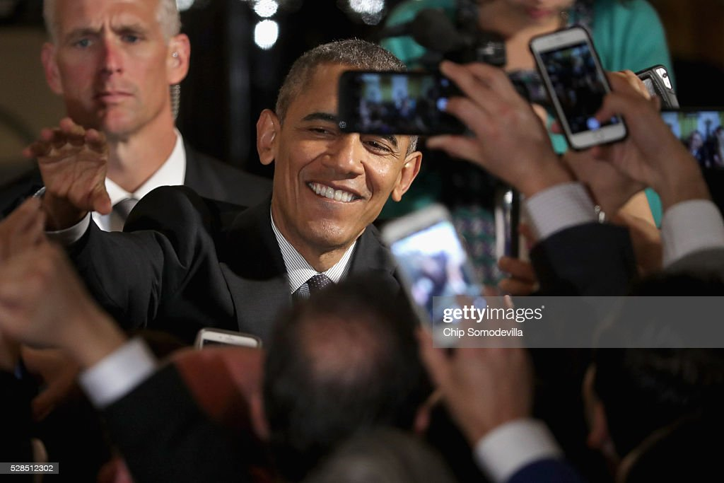 President Barack Obama greets guests during a reception to mark the Cinco de Mayo holiday in the East Room at the White House May 5, 2016 in Washington, DC. The holiday commemorates the Mexican Army's unlikely victory over French forces at the Battle of Puebla in on May 5, 1862.