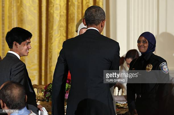 US President Barack Obama greets guests during an Iftar dinner celebrating Ramadan in the State Dining Room at the White House in Washington DC on...