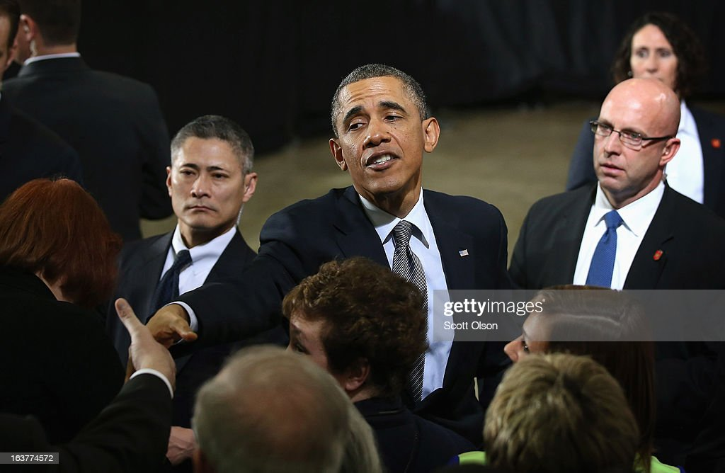 President <a gi-track='captionPersonalityLinkClicked' href=/galleries/search?phrase=Barack+Obama&family=editorial&specificpeople=203260 ng-click='$event.stopPropagation()'>Barack Obama</a> greets guests following a speech at Argonne National Laboratory on March 15, 2013 in Argonne, Illinois. Obama used the event to push for more federally funded research into clean energy technologies. Argonne is the current home of a $120 million federal project to develop smaller, cheaper and more powerful batteries for electric vehicles.