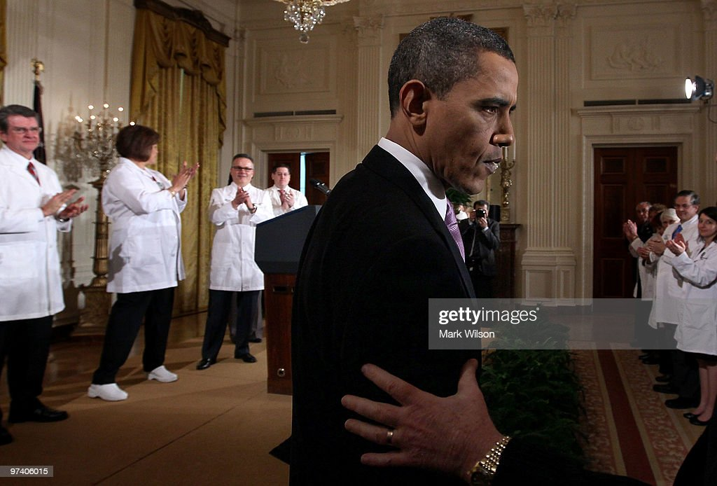 US President <a gi-track='captionPersonalityLinkClicked' href=/galleries/search?phrase=Barack+Obama&family=editorial&specificpeople=203260 ng-click='$event.stopPropagation()'>Barack Obama</a> greets health care workers after speaking about health care reform while during an event in the East Room at the White House on March 3, 2010 in Washington, DC. President Obama called on law makers to give his health care package that is before Congress an up or down vote.