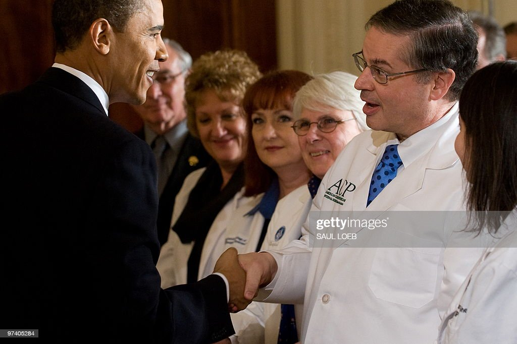 US President <a gi-track='captionPersonalityLinkClicked' href=/galleries/search?phrase=Barack+Obama&family=editorial&specificpeople=203260 ng-click='$event.stopPropagation()'>Barack Obama</a> greets healthcare professionals after speaking about his final strategy for moving forward with health insurance reform in the East Room of the White House in Washington, DC, March 3, 2010. AFP PHOTO / Saul LOEB