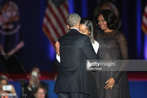 President Barack Obama greets his wife Michelle and daughter Malia following his farewell speech to the nation on January 10 2017 in Chicago Illinois...