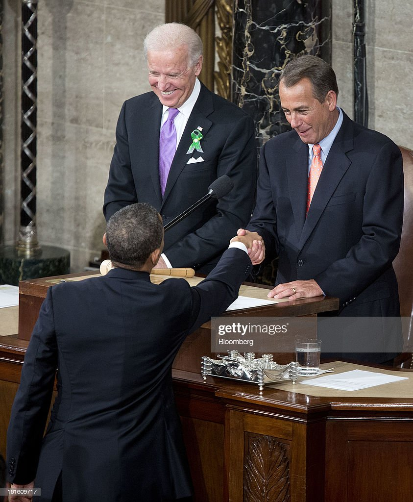 U.S. President Barack Obama greets House Speaker John Boehner, a Republican from Ohio, right, and Joseph 'Joe' Biden, U.S. vice president, before delivering the State of the Union address to a joint session of Congress at the Capitol in Washington, D.C., U.S., on Tuesday, Feb. 12, 2013. Obama called for raising the federal minimum wage to $9 an hour and warned he'll use executive powers to get his way on issues from climate change to manufacturing if Congress doesn't act, laying out an assertive second-term agenda sure to provoke Republicans. Photographer: Joshua Roberts/Bloomberg via Getty Images