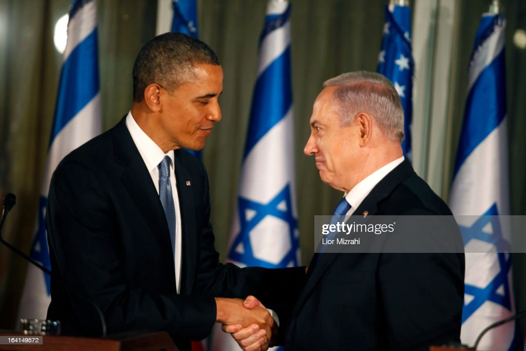 U.S. President <a gi-track='captionPersonalityLinkClicked' href=/galleries/search?phrase=Barack+Obama&family=editorial&specificpeople=203260 ng-click='$event.stopPropagation()'>Barack Obama</a> (L) greets Israeli Prime Minister <a gi-track='captionPersonalityLinkClicked' href=/galleries/search?phrase=Benjamin+Netanyahu&family=editorial&specificpeople=118594 ng-click='$event.stopPropagation()'>Benjamin Netanyahu</a> during a press conference on March 20, 2013 in Jerusalem, Israel. This is Obama's first visit as President to the region, and his itinerary will include meetings with the Palestinian and Israeli leaders as well as a visit to the Church of the Nativity in Bethlehem.