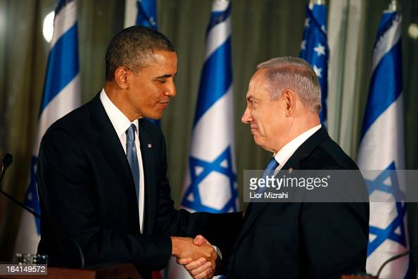 US President Barack Obama greets Israeli Prime Minister Benjamin Netanyahu during a press conference on March 20 2013 in Jerusalem Israel This is...
