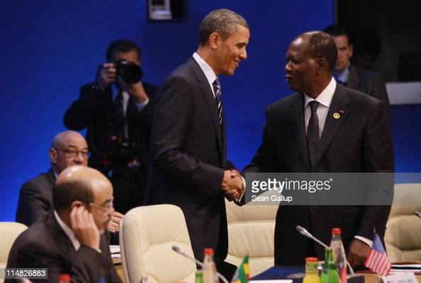 S President Barack Obama greets Ivory Coast President Alassane Ouattara at a meeting of G8 leaders and African leaders on the second day of the G8...