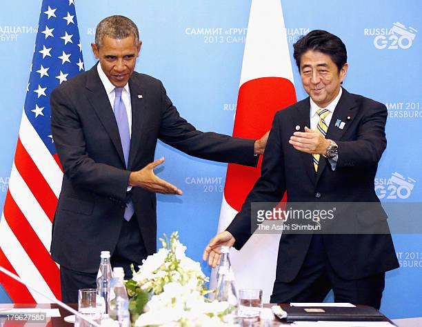 US President Barack Obama greets Japan Prime Minister Shinzo Abe at the G20 summit on September 5 2013 in St Petersburg Russia The G20 summit is...