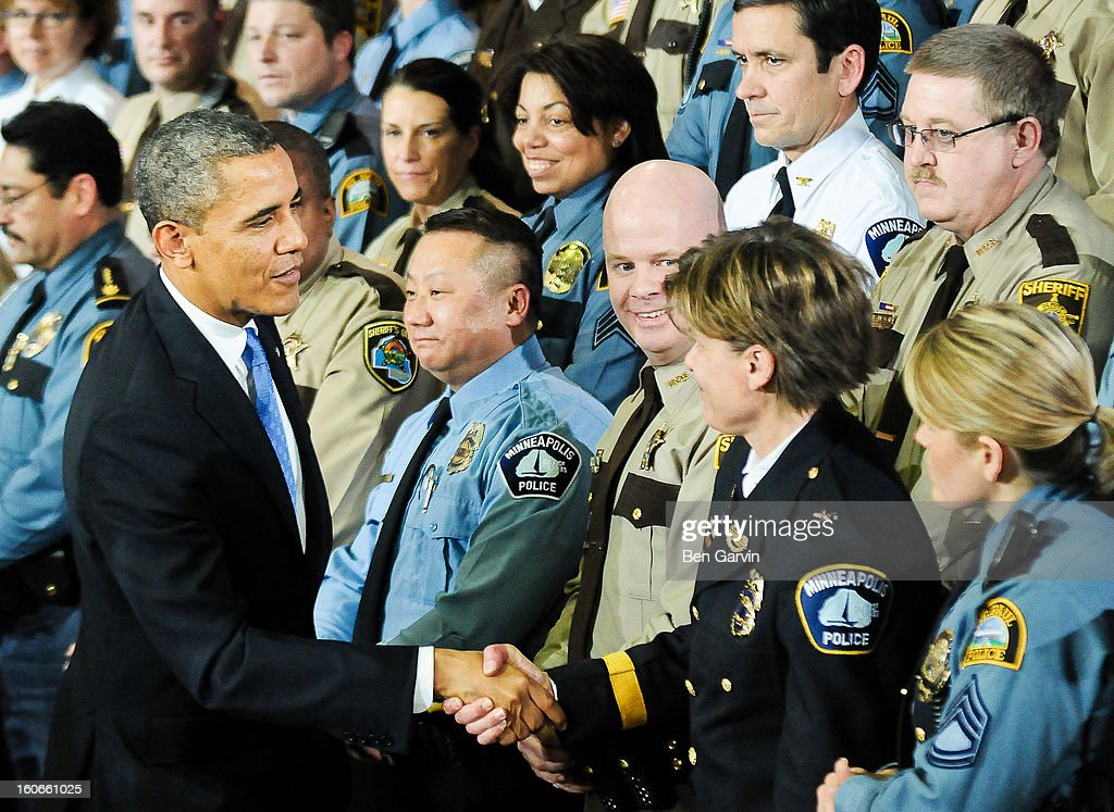 President Barack Obama greets law enforcement officers after speaking at the Minneapolis Police Department Special Operations Center on February 4, 2013 in Minneapolis, Minnesota. President Obama is promoting a ban on assault weapons and expanded background checks on gun buyers.