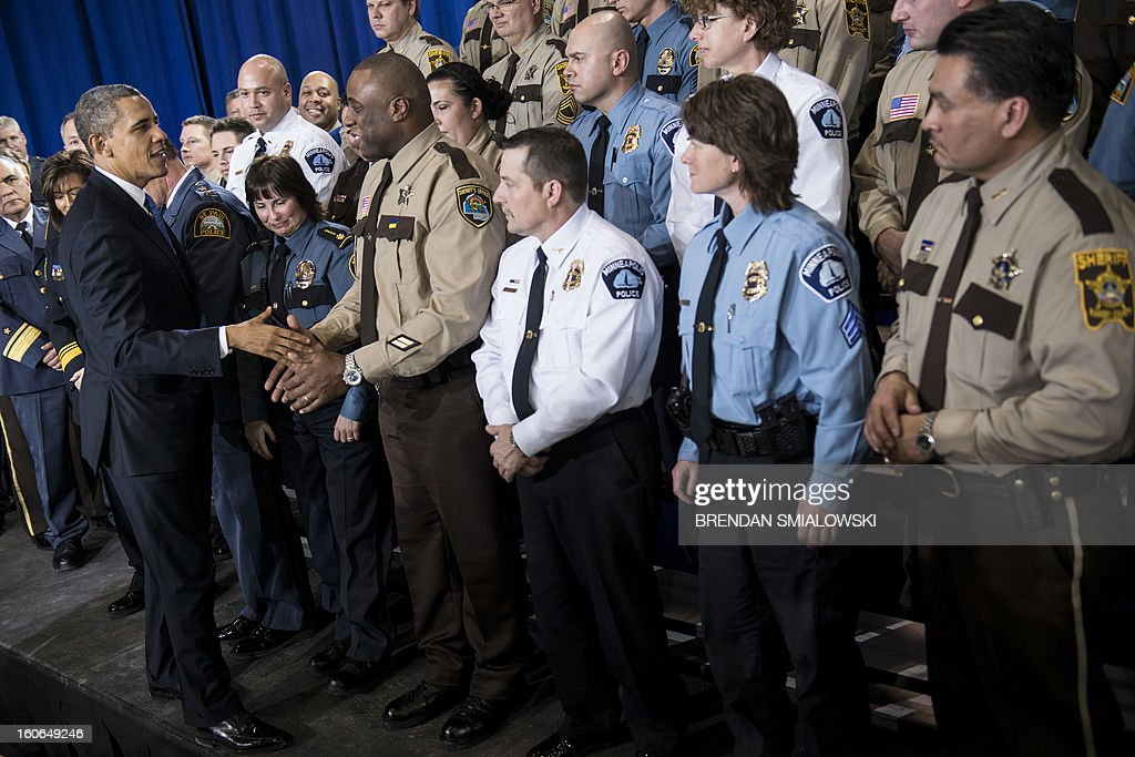 US President Barack Obama greets local law enforcement after speaking about gun violence at the Minneapolis Police Department's special operations center on February 4, 2013 in Minneapolis, Minnesota. Obama spoke after meeting with local leaders and law enforcement to discuss gun violence and local efforts to control it. AFP PHOTO/Brendan SMIALOWSKI