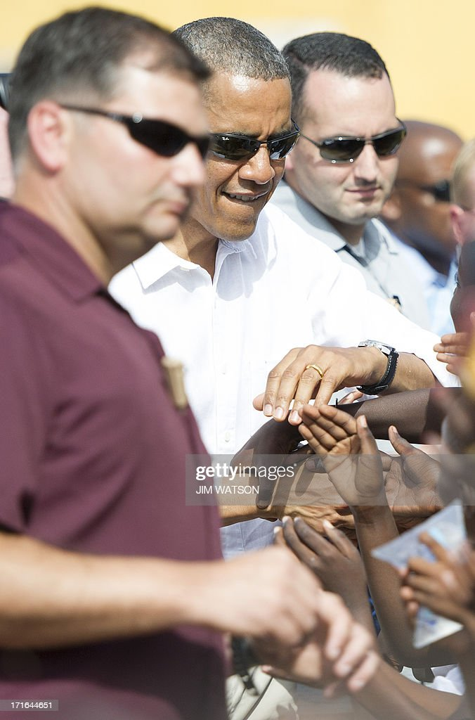 US President <a gi-track='captionPersonalityLinkClicked' href=/galleries/search?phrase=Barack+Obama&family=editorial&specificpeople=203260 ng-click='$event.stopPropagation()'>Barack Obama</a> (2nd L) greets locals as he tours Goree Island off the coast of Dakar, Senegal on June 27, 2013.