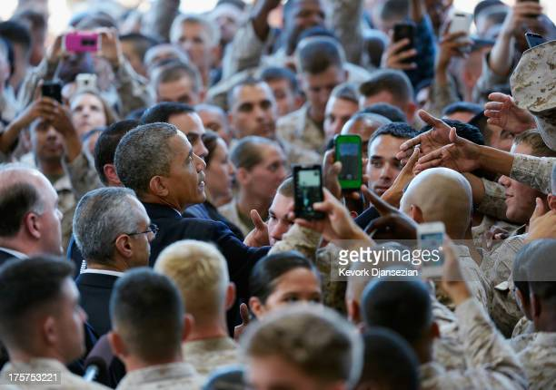 S President Barack Obama greets Marines after speaking at Camp Pendleton Marine Corps base visiting troops and their families to thank them for their...