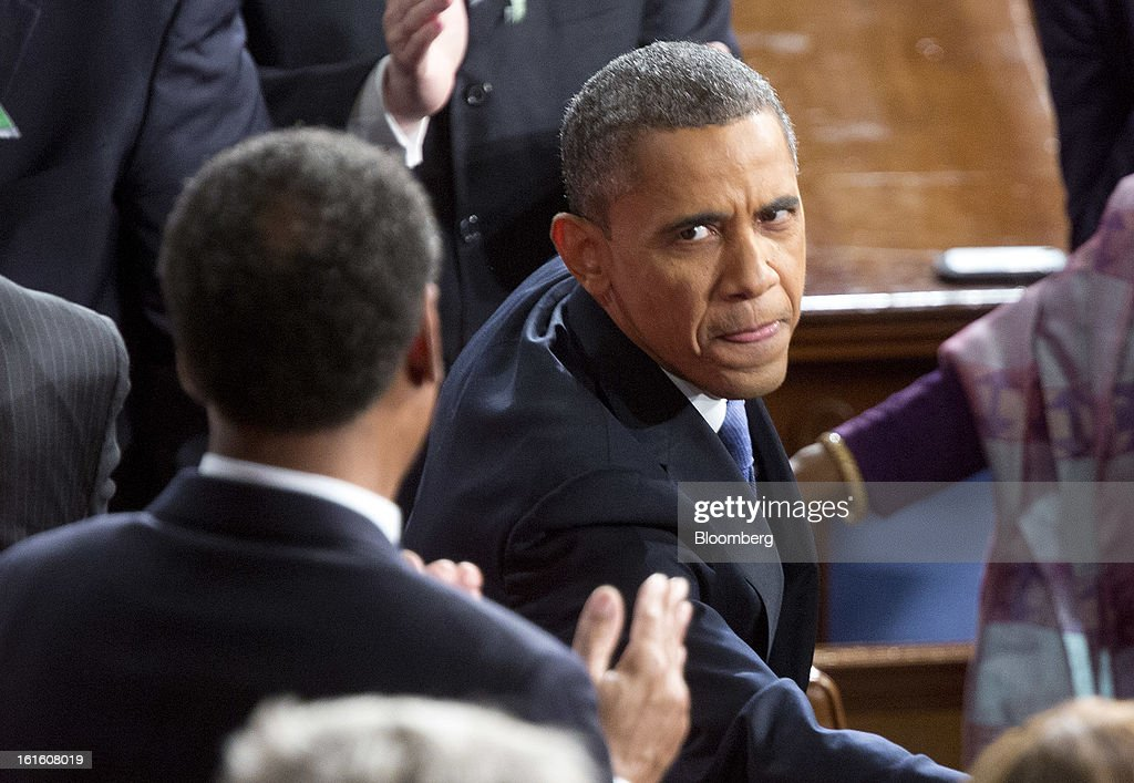 U.S. President Barack Obama greets members of Congress as he arrives to deliver the State of the Union address to a joint session of Congress at the Capitol in Washington, D.C., U.S., on Tuesday, Feb. 12, 2013. bama called for raising the federal minimum wage to $9 an hour and warned he'll use executive powers to get his way on issues from climate change to manufacturing if Congress doesn't act, laying out an assertive second-term agenda sure to provoke Republicans. Photographer: Joshua Roberts/Bloomberg via Getty Images