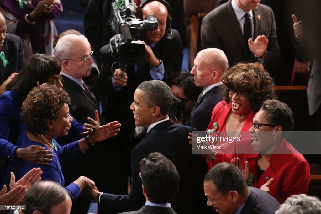 U.S. President Barack Obama (C) greets members of Congress before he delivers his State of the Union speech before a joint session of Congress at the U.S. Capitol February 12, 2013 in Washington, DC. Facing a divided Congress, Obama concentrated his speech on new initiatives designed to stimulate the U.S. economy and said, 'It's not a bigger government we need, but a smarter government that sets priorities and invests in broad-based growth'.