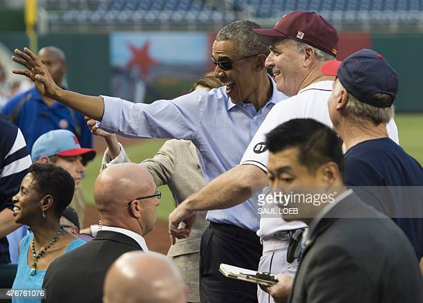 US President Barack Obama greets members of the Democratic team during the annual Congressional Baseball Game between the Democrats and Republicans...