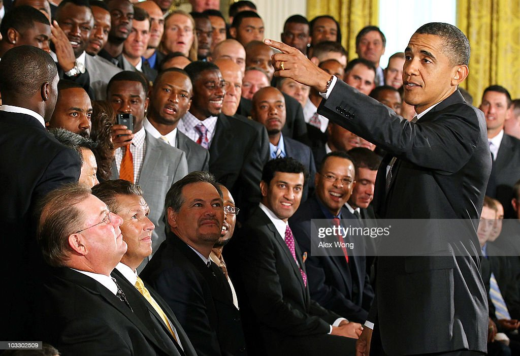 U.S. President <a gi-track='captionPersonalityLinkClicked' href=/galleries/search?phrase=Barack+Obama&family=editorial&specificpeople=203260 ng-click='$event.stopPropagation()'>Barack Obama</a> (R) greets members of the New Orleans Saints during a reception for the 2010 National Football League Super Bowl champions in the East Room of the White House August 9, 2010 in Washington, DC. The Saints, lead by head coach Sean Payton, finished the 2009-2010 season with a winning record of 13-3 and defeated the Indianapolis Colts to take the championship.