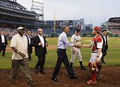 US President Barack Obama greets members of the Republican team during the annual Congressional Baseball Game between the Democrats and Republicans...