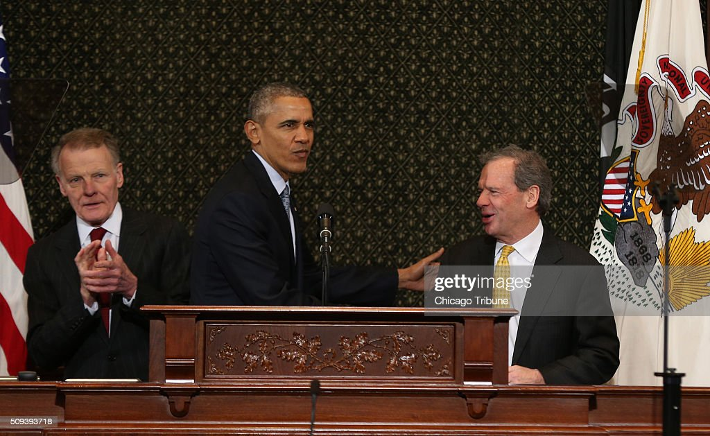 President Barack Obama greets Michael J. Madigan, Speaker of the Illinois House, and John Cullerton, President of the Senate, as he prepares to speak to Illinois lawmakers in the House chamber of the State Capitol in Springfield, Ill., on Wednesday, Feb. 10, 2016.