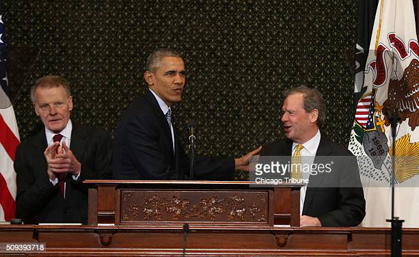 President Barack Obama greets Michael J Madigan Speaker of the Illinois House and John Cullerton President of the Senate as he prepares to speak to...