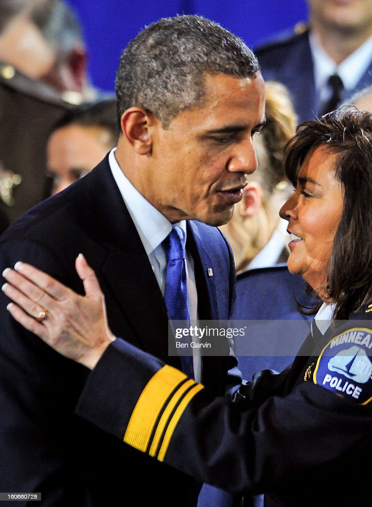 President <a gi-track='captionPersonalityLinkClicked' href=/galleries/search?phrase=Barack+Obama&family=editorial&specificpeople=203260 ng-click='$event.stopPropagation()'>Barack Obama</a> greets Minneapolis Police Chief Janee Harteau, who introduced the President, after speaking before a group of local leaders and law enforcement officials at the Minneapolis Police Department Special Operations Center on February 4, 2013 in Minneapolis, Minnesota. President Obama is promoting a ban on assault weapons and expanded background checks on gun buyers.