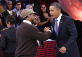 S President Barack Obama greets moderator Sway Calloway while participating in a Town Hall on Viacom�s BET CMT and MTV networks October 14 2010 in...