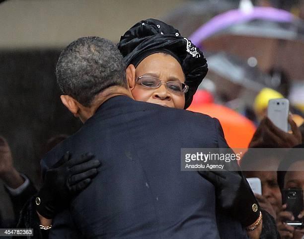 President Barack Obama greets Nelson Mandela's widow Graca Machel during the memorial service for the late South African President Nelson Mandela at...
