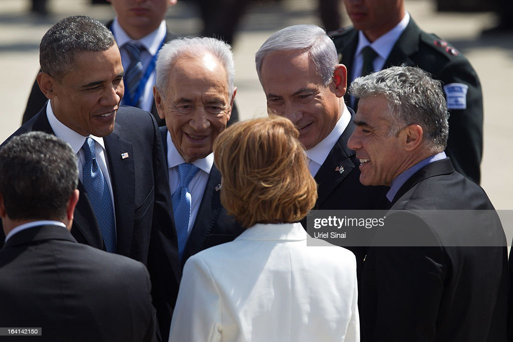 US President Barack Obama greets new Israeli Finance Minister Yair Lapid (R), beside Israeli President Shimon Peres (2nd L) and Israeli Prime Minister Benjamin Netanyahu (2nd R), during an official welcoming ceremony on his arrival at Ben Gurion International Airport on March, 20, 2013 near Tel Aviv, Israel. This will be Obama's first visit as President to the region, and his itinerary will include meetings with the Palestinian and Israeli leaders as well as a visit to the Church of the Nativity in Bethlehem.