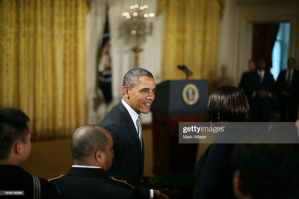 U.S. President Barack Obama greets newly sworn in United States citizens during a naturalization ceremony in the East Room of the White House on March 25, 2013 in Washington DC. Homeland Security Secretary Janet Napolitano administered the oath of allegiance to active duty service members and civilians officially granting them United States citizenship.