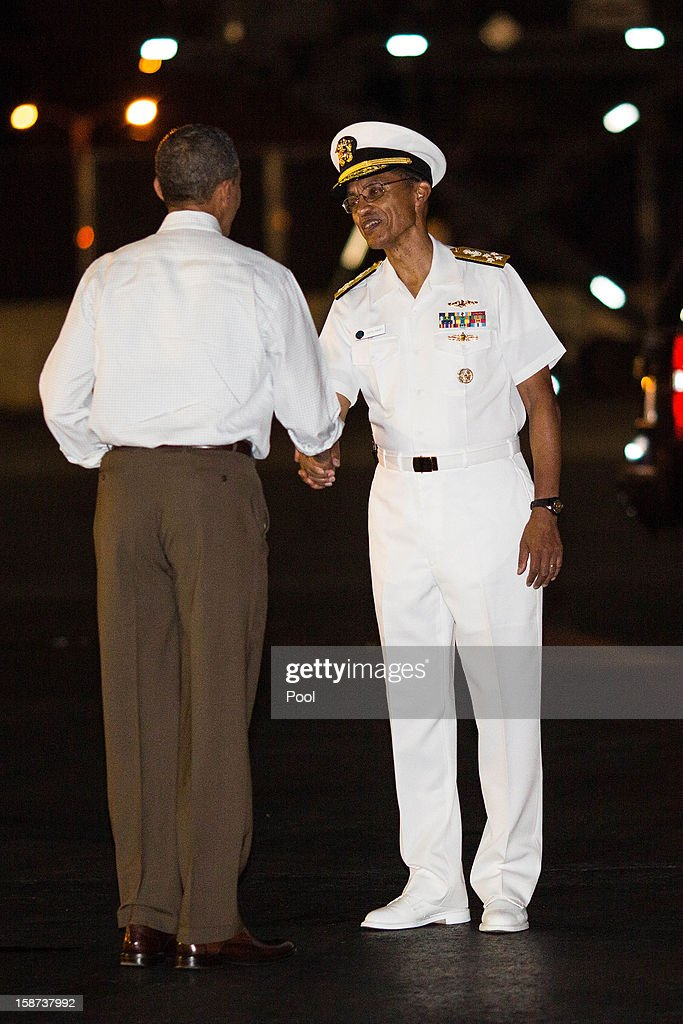 US President Barack Obama greets Pacific Fleet Commander Cecil D. Haney before boarding Air Force One at Joint Base Pearl Harbor-Hickam on December 26, 2012 in Honolulu, Hawaii. The president, who was spending a traditional Christmas holiday with his family in Hawaii, has been forced to cut his Christmas break short by the fiscal cliff crisis.
