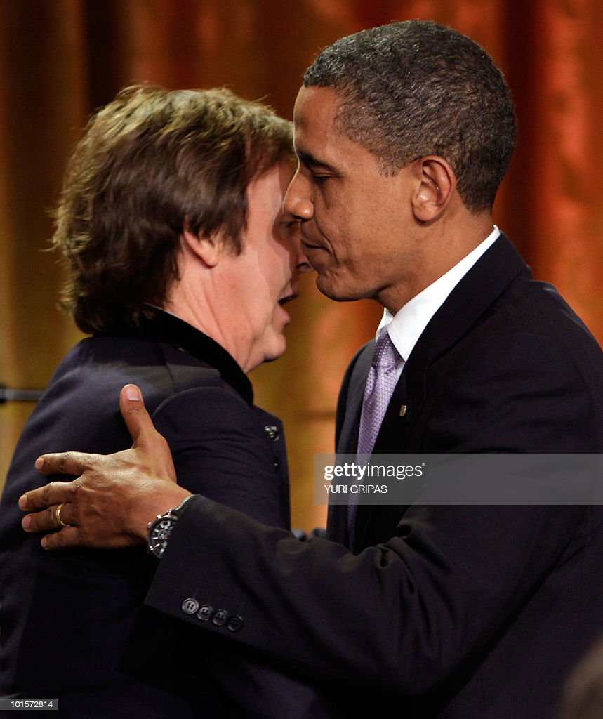 US President Barack Obama (R) greets Paul McCartney after awarding him the third Gershwin Prize for Popular Song at the White House in Washington, DC on June 2, 2010. McCartney's appearance was part of a two-day series of events marking the award issued by the Library of Congress.