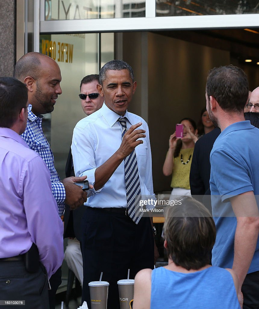 President <a gi-track='captionPersonalityLinkClicked' href=/galleries/search?phrase=Barack+Obama&family=editorial&specificpeople=203260 ng-click='$event.stopPropagation()'>Barack Obama</a> greets people after picking up lunch at the Taylor Gourmet Deli, October 4, 2013 in Washington, DC. Democrats and Republicans are still at a stalemate on funding for the federal government as the shut down goes into the fourth day.