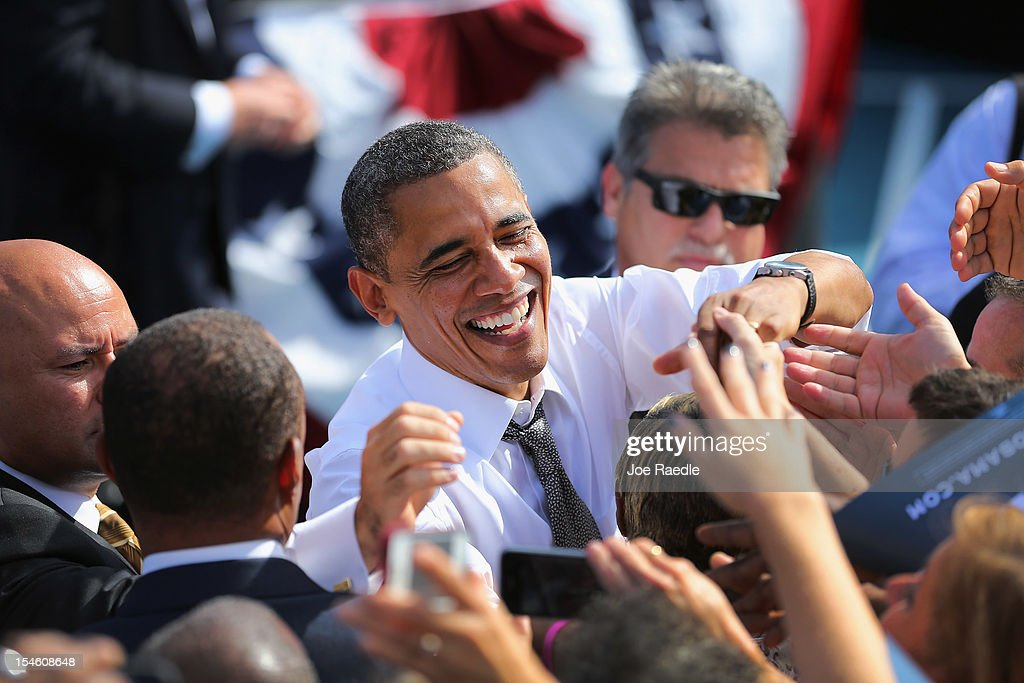 U.S. President <a gi-track='captionPersonalityLinkClicked' href=/galleries/search?phrase=Barack+Obama&family=editorial&specificpeople=203260 ng-click='$event.stopPropagation()'>Barack Obama</a> greets people after speaking during a campaign rally at the Delray Beach Tennis Center on October 23, 2012 in Delray Beach, Florida. Obama continues to campaign across the U.S. in the run-up to the November 6, presidential election.