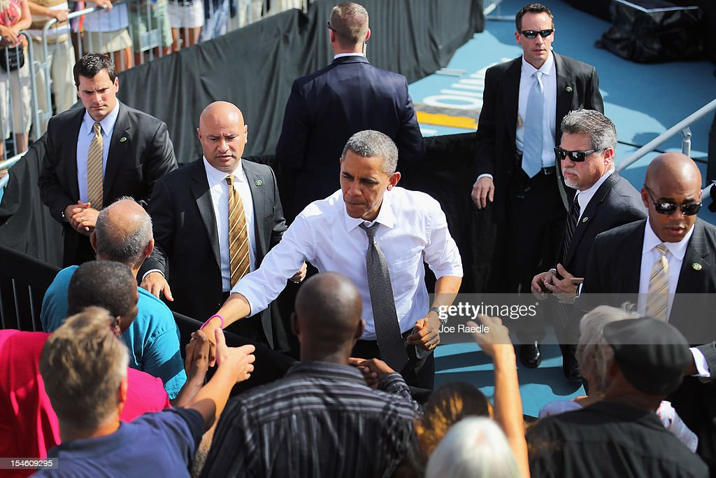 U.S. President <a gi-track='captionPersonalityLinkClicked' href=/galleries/search?phrase=Barack+Obama&family=editorial&specificpeople=203260 ng-click='$event.stopPropagation()'>Barack Obama</a> greets people after speaking during a campaign rally at the Delray Beach Tennis Center on October 23, 2012 in Delray Beach, Florida. President Obama continues to campaign across America.