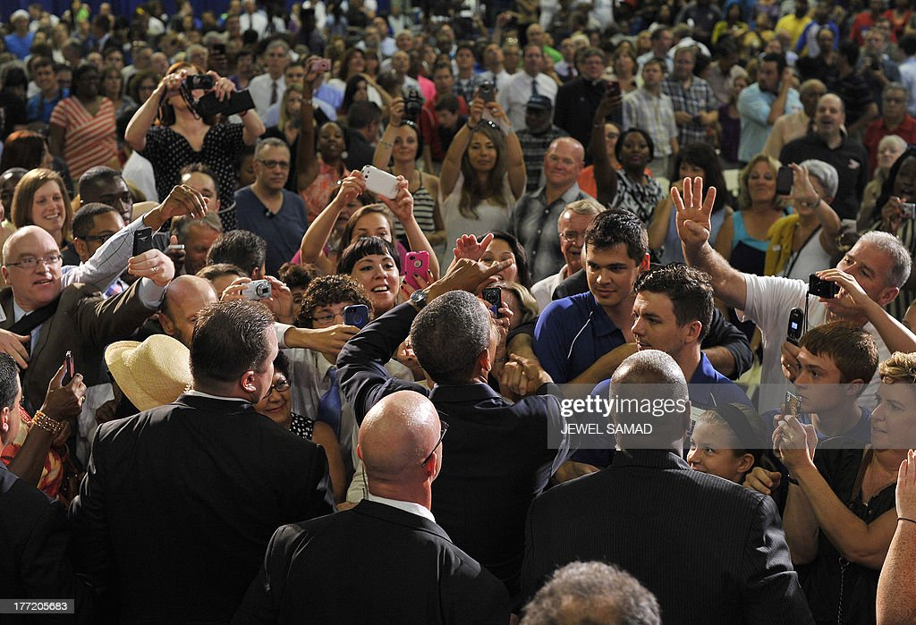 US President Barack Obama greets people after speaking on education at University of Buffalo, the State University of New York, on August 22, 2013 in Buffalo, New York. Obama is on a two-day bus tour through New York and Pennsylvania to discuss his plan to make college more affordable, tackle rising costs, and improve value for students and their families. AFP Photo/Jewel Samad