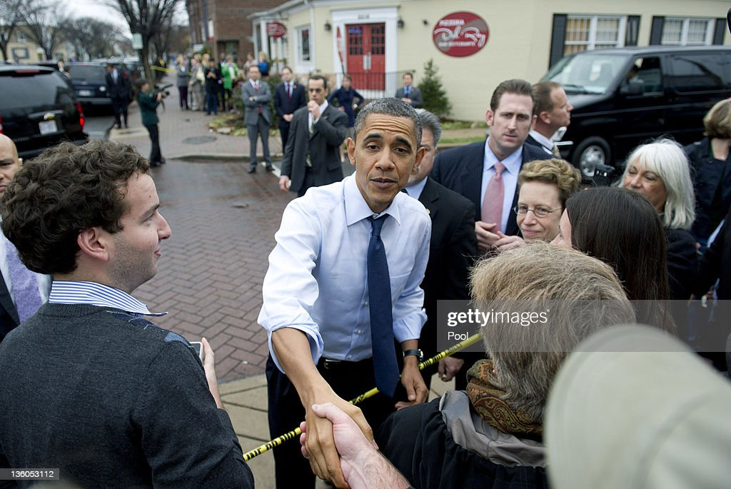 U.S. President Barack Obama greets people after stopping for pizza at Del Ray Pizzaria on December 21, 2011 in Alexandria, Virginia. President Obama called on House Speaker Rep. John A. Boehner (R-OH) on to urge him again to allow a vote on a Senate-passed measure that would extend a payroll tax holiday for two months.