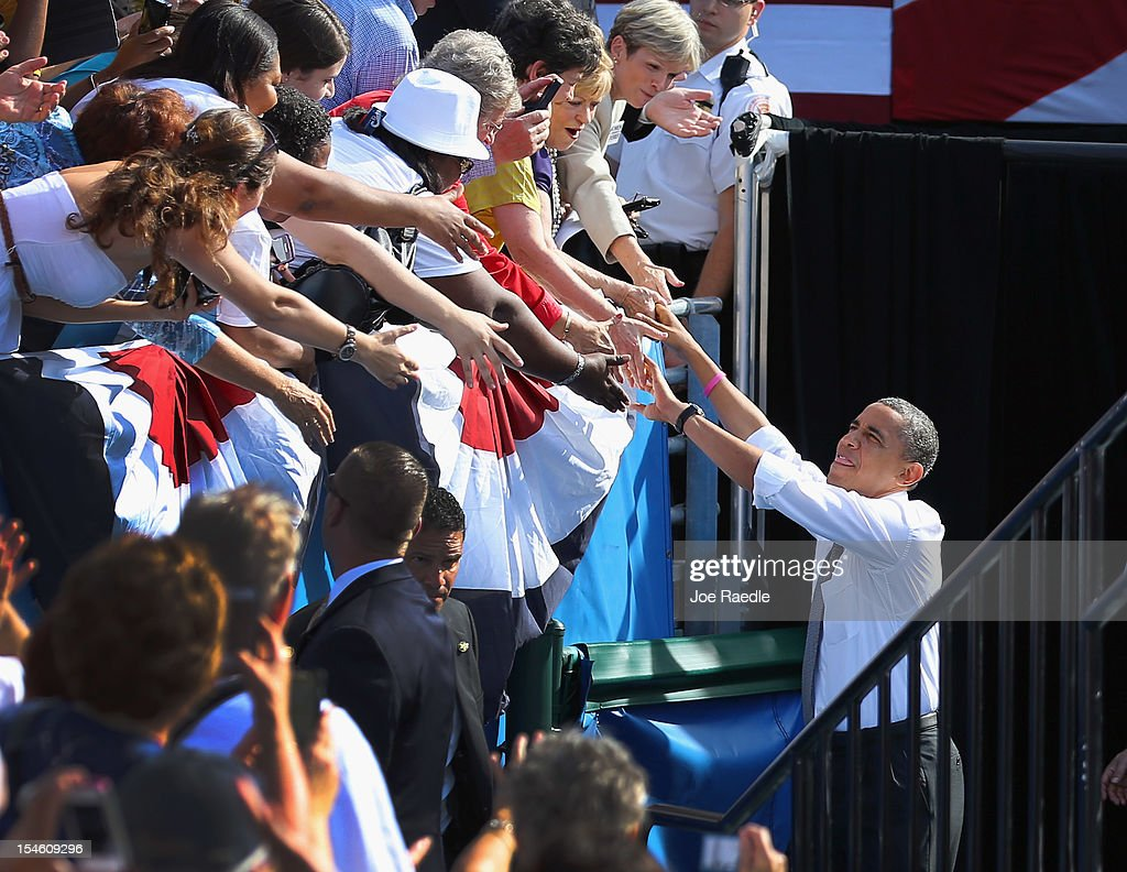 U.S. President <a gi-track='captionPersonalityLinkClicked' href=/galleries/search?phrase=Barack+Obama&family=editorial&specificpeople=203260 ng-click='$event.stopPropagation()'>Barack Obama</a> greets people during a campaign rally at the Delray Beach Tennis Center on October 23, 2012 in Delray Beach, Florida. President Obama continues to campaign across America.