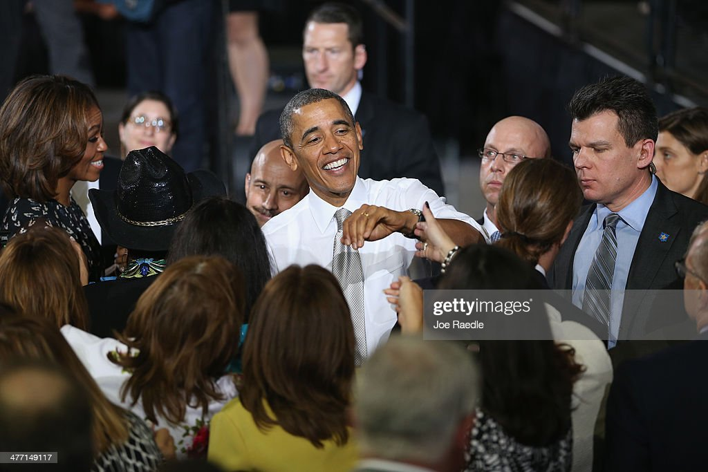 U.S. President Barack Obama greets people during an event at Coral Reef Senior High on March 7, 2014 in Miami, Florida. Obama announced a program that will allow students an easier way to complete the Free Application for Federal Student Aid.