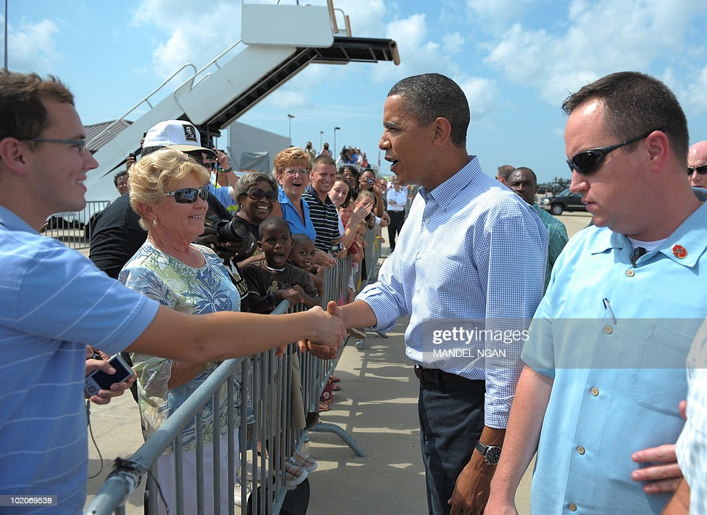 US President Barack Obama greets people watching his arrival after stepping off Air Force One on June 14, 2010 upon arrival at Gulfport-Biloxi International Airport in Gulfport, Mississippi. Obama is heading to the Gulf of Mexico to tour the areas stricken by the BP oil leak. AFP PHOTO/Mandel NGAN