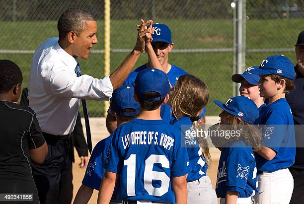 S President Barack Obama greets players as he visits a little league baseball game at Friendship Park May 19 2014 in Washington DC