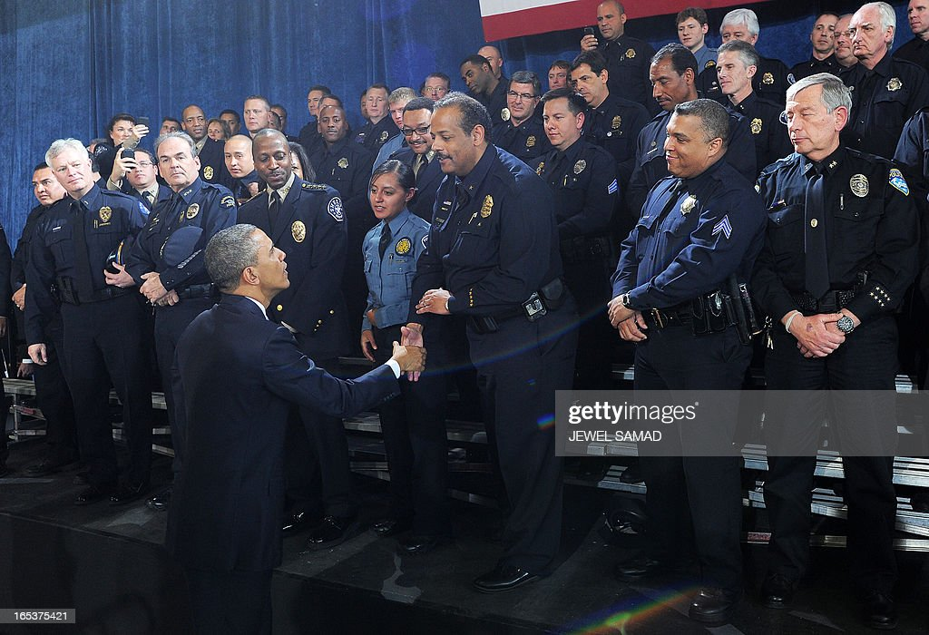 US President Barack Obama greets police officers after speaking on common-sense measures to reduce gun violence at the Denver Police Academy in Denver, Colorado, on April 3, 2013, as he continues asking the American people to join him in calling on Congress to pass common-sense measures to reduce gun violence. The president has demanded votes on measures including a requirement for background checks on all gun purchases, limits on high capacity ammunition magazines, a reinstated assault weapons ban, new gun trafficking laws, and new school safety plans. But the assault weapons ban push appears certain to fail to get sufficient support in the Senate, following a huge campaign by the gun lobby and opposition from Republicans and Democrats from conservative and rural areas. AFP PHOTO/Jewel Samad